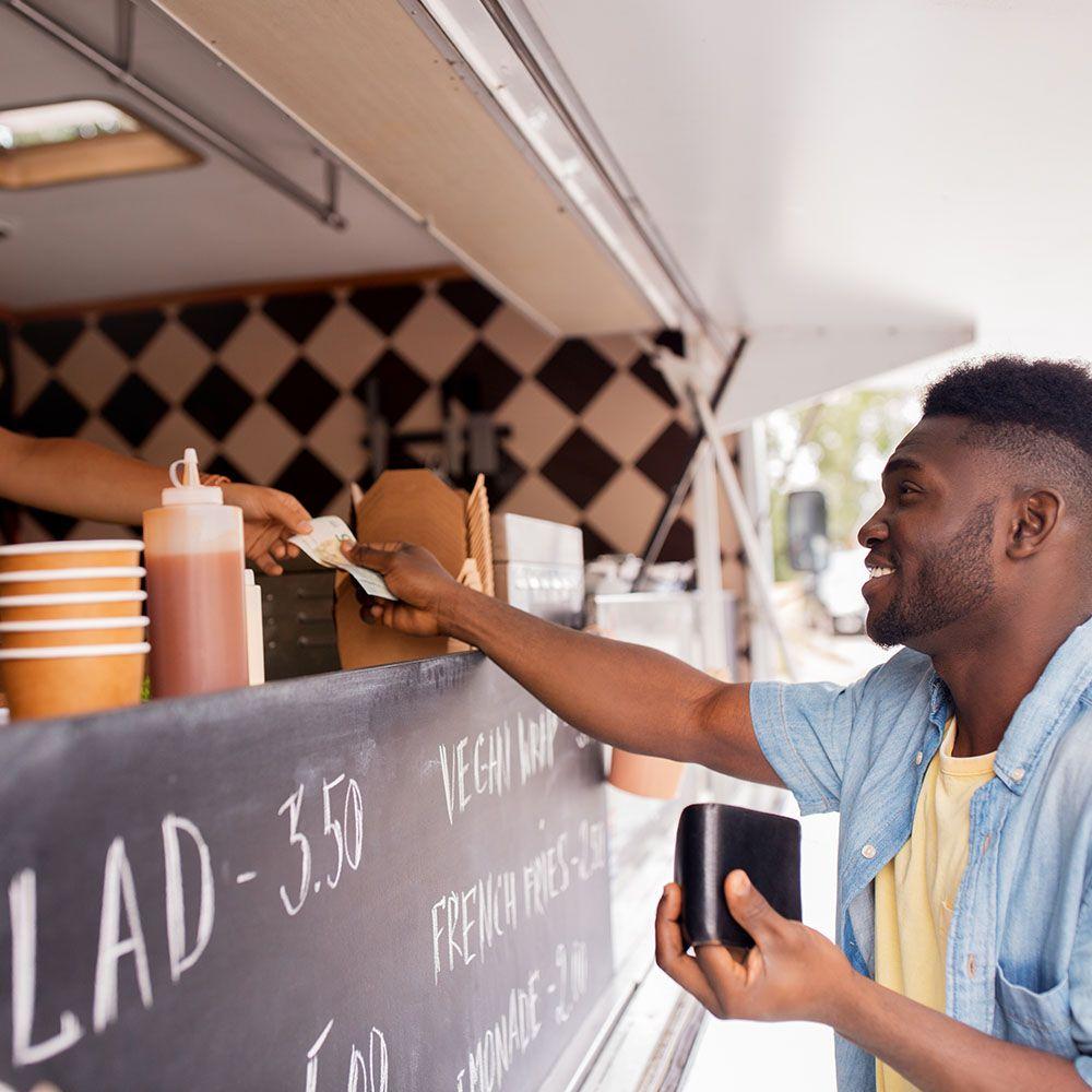 MSD locations   african american man buying wok at food truck PHQLTMN